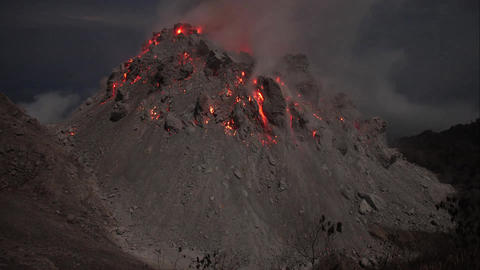 Time lapse footage showing nighttime eruption of Paluweh volcano, Indonesia Footage