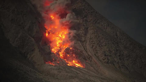 Glowing rockfall of hot lava cascading down the flank of Mount Sinabung volcano Footage