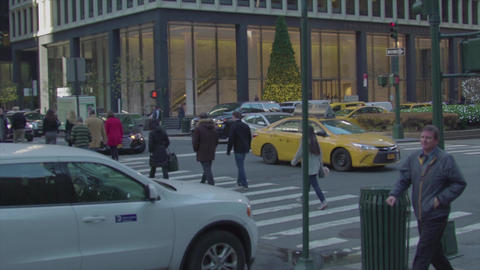 Taxis and people going through the intersection NEW YORK slow motion Footage