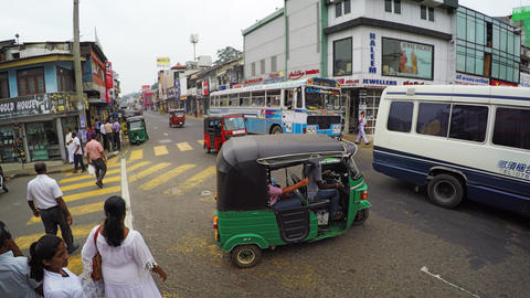 Public transportation at a busy intersection in Kandy Footage