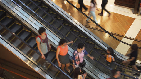 Guests ascending and descending escalators at Shoppes at Marina Bay Sands Footage
