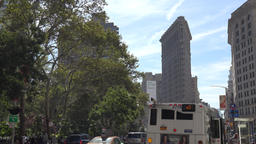 USA New York City Manhattan public bus departs in front of Flatiron building Footage