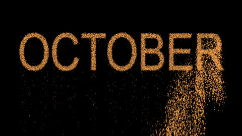 name of the month OCTOBER appears from the sand, then crumbles. Alpha channel Animation