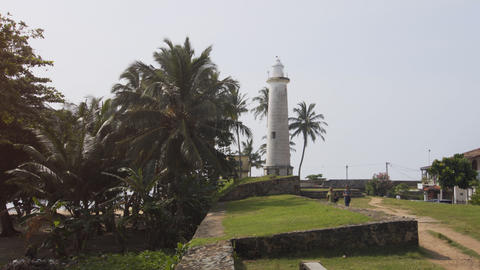 Tourists visiting lighthouse over Galle Fortress in Sri Lanka Footage