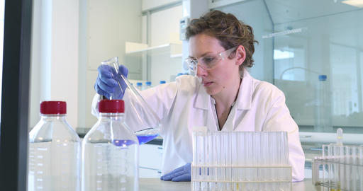 Female scientist working in a science laboratory Footage