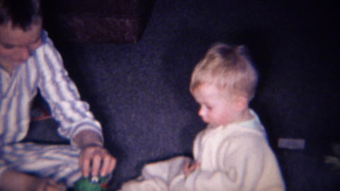 1961: Brother teaching baby jack in the box pop goes the weasel Footage