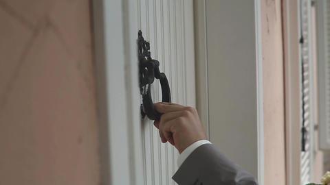 Man's Hand Knocking Door Handle Footage