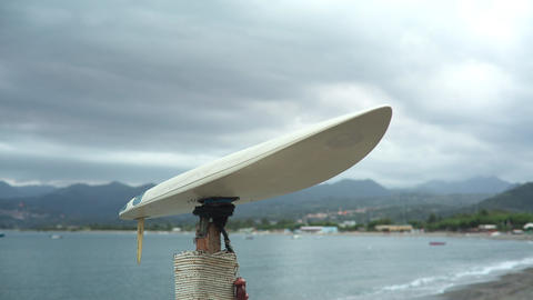 White Surf Board On A Stick Footage