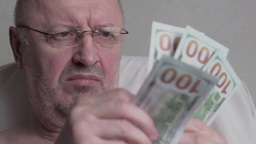 Retired Man Counts Money stock footage