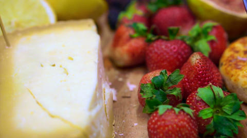 Cheese with strawberry, berries and fruits on wood platter ライブ動画