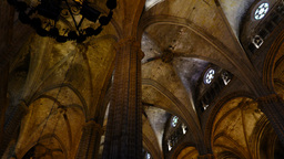 Arched ceiling at Gothic Cathedral, panning shot, round windows under roof Footage