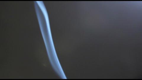 Smoke & Fume (Reek) on a gray background. Fire not in shot Footage