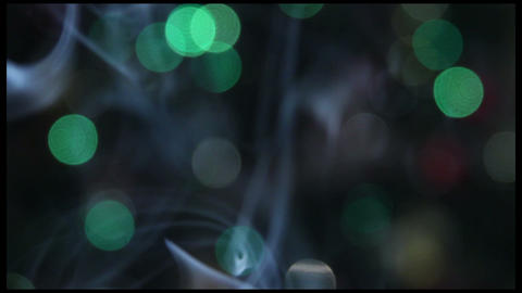Smoke (fume, reek) & the Christmas Tree Lights background. fire not in shot Footage