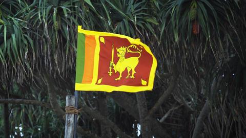 Sri Lankan National Flag Flapping in the Wind in Hikkaduwa Footage