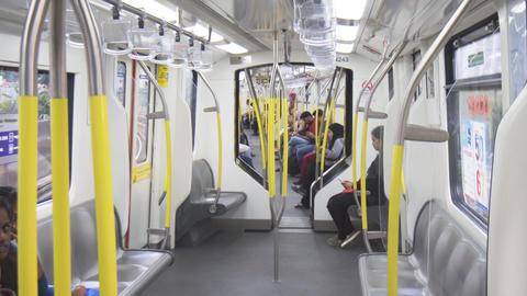 Passengers onboard a rapidKL commuter train. FullHD video Footage