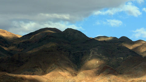 Cloud shadows over mountains timelapse Footage