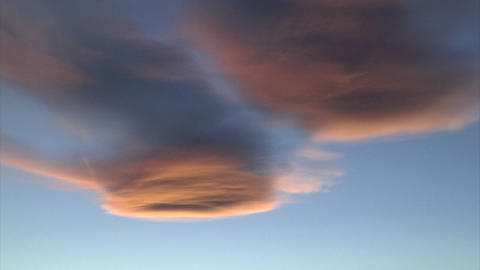 Clouds reflecting sunset light Footage