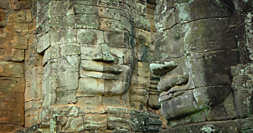 Human faces carved on the walls of the Bayon temple. Cambodia. Angkor ruins Footage