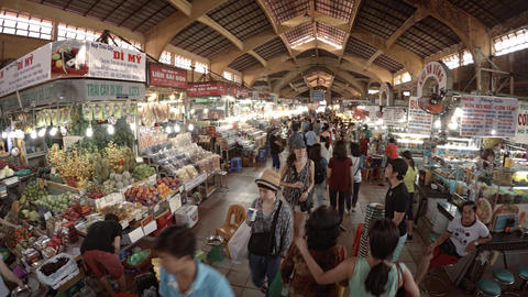 Shoppers Strolling through Ben Thanh Market in Vietnam Live Action