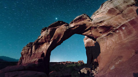Dawn breaking over rock arches Live Action