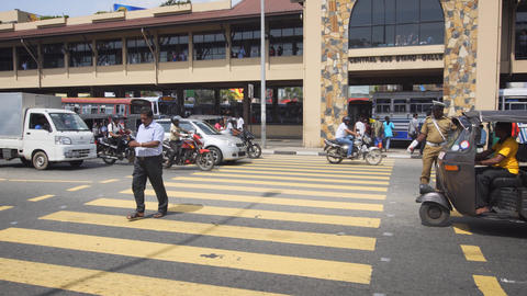 Police officer directs traffic in front of the Central Bus Stand in Galle Footage