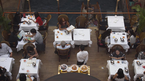 Guests enjoy fine dining in the Shoppes at Marina Bay Sands in Singapore Live Action