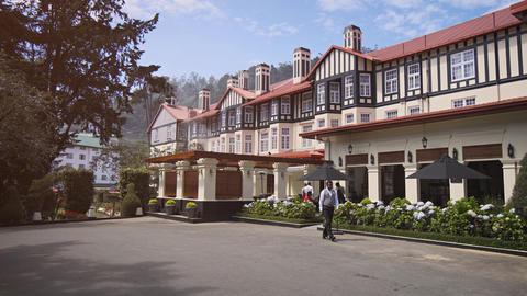 Guests dine in the garden of the Grand Hotel Nuwara Eliya Footage