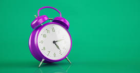 Metal violet vintage alarm clock time lapse copy space green background Animación