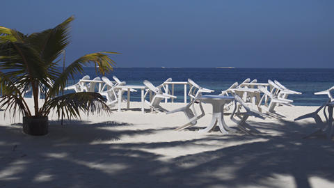 Dining Tables and Chairs on Tropical Beach in the Maldives Footage