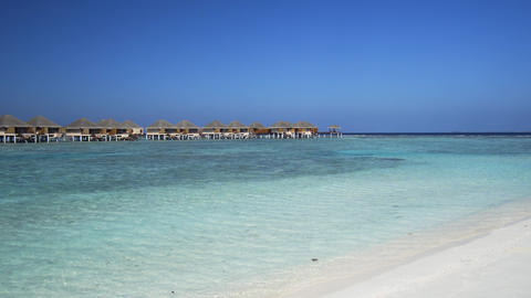 Private Bungalows against a Bold Horizon in the Maldives Live Action