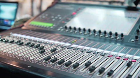 Hand of the sound producer. Controls of video and audio mixing console. close up Image