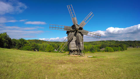 Ukraine. Ancient wooden windmill in a meadow Footage