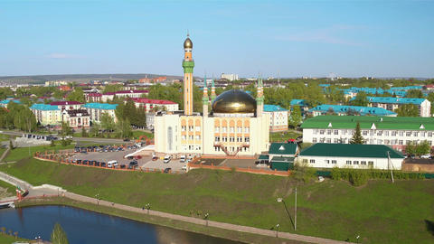 Flycam Shows Old Mosque with Shining Golden Domes Footage