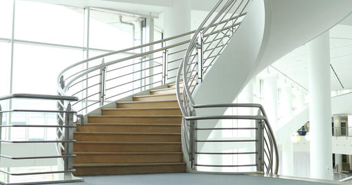 Female business colleagues walking down spiral staircase Footage