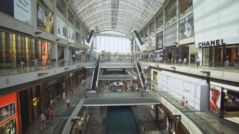 Shoppers strolling through the Shoppes at Marina Bay Sands. in Singapore Live Action