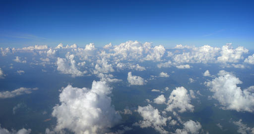 Puffy Popcorn Clouds from Airplane Window. 4k DCI footage Footage