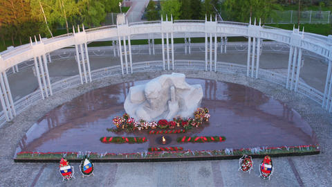 Drone Removes above Memorial Complex with Flame Footage