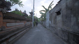 Man Walking Down an Indonesian Street Footage