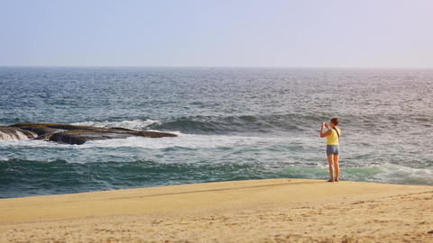 Tourist Photographing Sri Lankan Seascape from Sandy Beach Footage