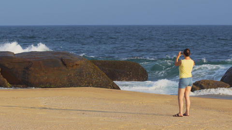 Tourist Photographing Seascape from Sandy Beach in Sri Lanka Footage