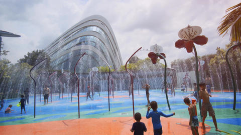 Children playing at Gardens by the Bay's Kids' water park Footage