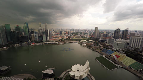 View of bay from the roof of Marina Bay Sands in cloudy weather. Singapore Footage