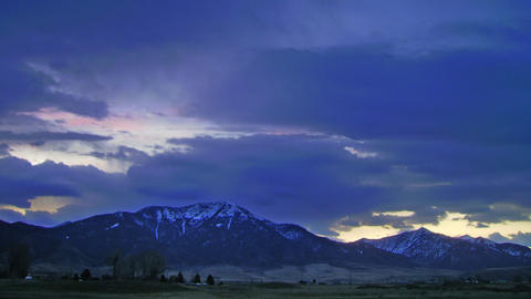 Time lapse colorful clouds over snowy mountains Footage