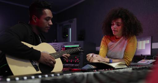 Songwriter writing lyrics in a music recording studio Footage