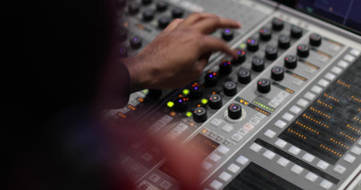 Closeup hands working a control mixer in a recording studio Live Action