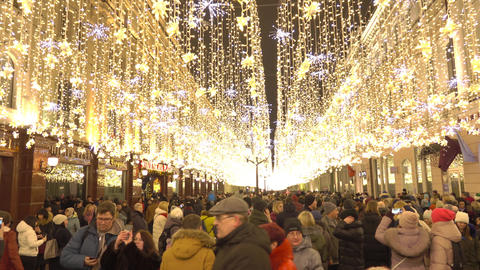 MOSCOW, RUSSIA - JANUARY 2, 2018. Crowded Nikolskaya street illuminated for Footage