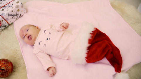 Adorable two-month baby girl inside santa's hat Footage