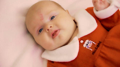 Adorable baby girl in santa's dress Footage