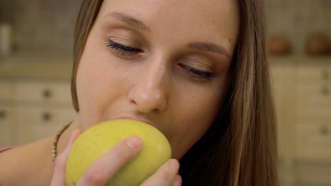 Pretty woman eats apple Footage