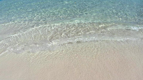 Transparent sea water and white coral sand on Maldives beach Footage
